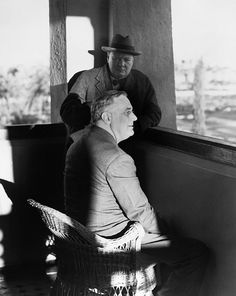 British Prime Minister Winston Churchill, standing, and President Franklin D. Roosevelt in Marrakesh, French Morocco, 24 January 1943, following the Casablanca Conference.