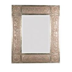 "This ornate frame features heavily distressed, golden-champagne leaf with black undertones, deep red dry brushing and a heavy rusty tan wash. Mirror has a generous 1 1/4"" bevel."