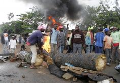 Residents block a road as they protest the killings of two locals earlier in the morning, claiming the crimes were committed by members of the United Nations Organization Mission in the Democratic Republic of the Congo (MONUC) and the Congolese army, in Beni in North Kivu province October 22, 2014. REUTERS-Kenny Katombe