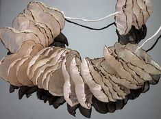Necklace, burnt & dyed paper, candle wax,iron, cotton thread, by Inni 2008