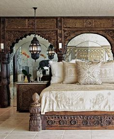 So often heavy traditional furniture would crowd and overpower a room. I've seen architectural pieces used as a headboard before, but never would have concieved of puting a mirror behind them to open up the space. Bohemian Room, Bohemian Style Bedrooms, Indian Style Bedrooms, Exotic Bedrooms, Home Bedroom, Master Bedroom, Bedroom Furniture, Bedroom Linens, Dream Bedroom