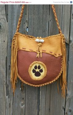 Buckskin tote with beaded wolf paw totem Fringed by thunderrose, $240.30