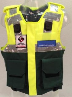 Cover: Protective Armour Waistcoat Style Vest, features: Waistcoat Style with front zip opening. Radio Loops. 2 Large Notebook pockets Shoulder and Side Adjustment. Loop Velcro front and back for badge placement. Internal Mesh and Spacer Lining for heat management and improved comfort. Standard Colour Options: Black or Navy Blue Fully machine washable once panels are removed. Compatible with complete range of soft armour protection solutions.