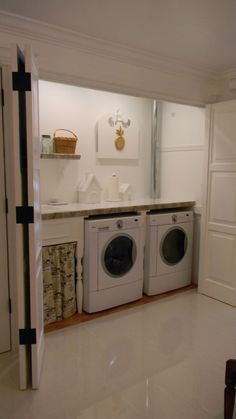 Hide away laundry room. There are poles up inside the soffit, running the full width of the area for items that can't be put in the dryer. The houses hide outlets and give access to hookups under the counter. All the doors in this area are old wood garage doors.