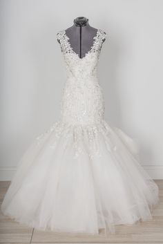 Ysa Makino - 68866 - Mermaid silhouette wedding dress for sale online with Borrowing Magnolia.  Deep-V back, illusion lace straps, fitted bodice.  Save thousands on designer wedding dresses online.  Rent or buy designer wedding dresses at borrowingmagnolia.com.