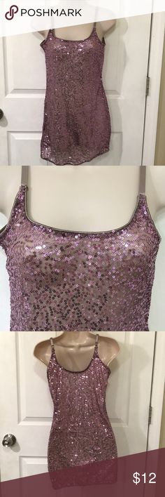 Purple Sequin Tank Top Worn once! Sequined tank top from Charlotte Roos. Size small. The material is see-through, covered with purple colored sequins. Adjustable spaghetti straps and the bottom has an elastic band.  Perfect for a New Year's party or a night out! Charlotte Russe Tops Tank Tops