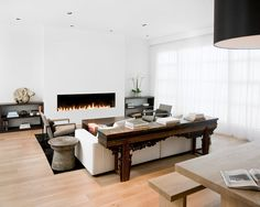 """In the Pacific Heights neighborhood of San Francisco, what started off as a decorating job turned into a full-blown renovation for Nicole Hollis, founder of Nicole Hollis Interior Design. """"When I walked inside, I knew it needed to be redone,"""" she recalls. """"The cabinets were made of plastic laminate that was peeling off, it was really small, and the rooms just didn't fit."""" The living room and dining room were originally separated by a central fireplace, which Hollis removed to create this…"""