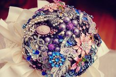 Apparently Miranda Lambert had a fabulous broach bouquet at her wedding. At the bridal shower everyone give you a special bin/broach, that way when you walk down the isle you have a little piece of everyone with Purple Brooch Bouquet, Wedding Brooch Bouquets, Boquet Wedding, Flower Brooch, Brooch Pin, Purple Wedding, Wedding Flowers, Dream Wedding, Gold Wedding