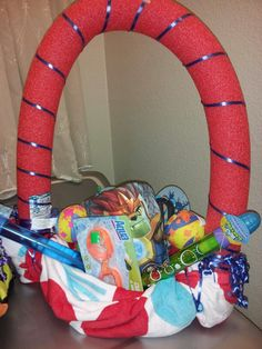 Easter Basket my boyfriend & I made for his son...everything we got from Fallas (Towel, Flip Flops, Swim trunks, Goggles) and the Dollar Store (Pool noodle, water gun, bubbles, splash balls)...