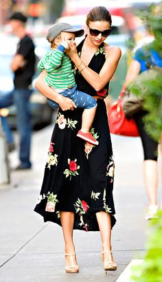 Miranda Kerr  Orlando Bloom's wife strolled New York City's streets in a floral print dress while little Flynn, 18 months, opted for stripes and pants with a fish print.