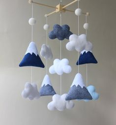 The mobile can be defined as moving sculpture. Early mobiles did not necessarily move, as do most crib mobiles today. The modern crib mobile is… Navy Nursery, Rustic Nursery, Woodland Nursery Decor, Nursery Crafts, Nursery Themes, Nursery Ideas, Baby Wall Decor, Mountain Nursery, Diy Crib