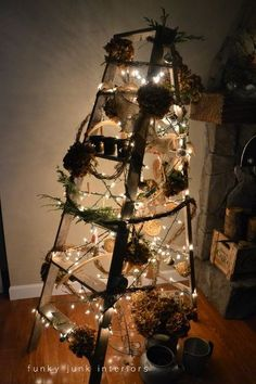a treeless ladder christmas tree, repurposing upcycling, seasonal holiday d cor, You have no idea how bright a treeless tree when the lights go out Those branches really hold back light But not this year