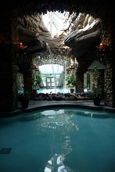 Secret Swimming Cave. Small offshoot of pool, surrounded in rock, with opening…