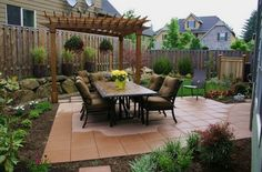 A pergola, some stones, and some lawn furniture, and I'm happy. But my husband wants nothing to do with the backyard!