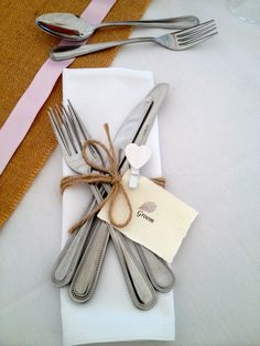 Twine napkin rings and hessian table runners