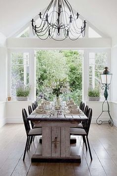 The Design Ideas of Cozy Dining Room Cozy dining room with long wooden dining table- a flower vase on the table and white wall painting – Coolitdoc Country Dining Rooms, Elegant Dining Room, Dining Room Design, Design Room, Room Photo, 25 Beautiful Homes, Beautiful Wall, Dining Table, Dining Area