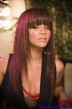 Rihanna with aubergine hair, bangs and long layers