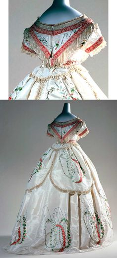 Evening dress, France, ca. 1864. Two pieces (bodice and skirt) of ivory silk taffeta with chenille fringe on bodice, waist, and back of skirt; embroidered flowers, leaves, and abstract shapes on skirt.