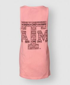 Rock this soft breezy tank all summer long! It is a coral loose fit tank made of 100% cotton. Featuring a mint colored pocket on the front left saying Texas Aggies in black font. On the back of the tank is a large, black, tribal print block ATM.