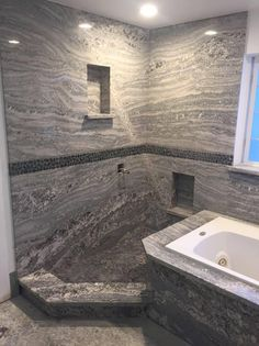 This Monte Cristo Granite Shower Definitely Makes A Statement!