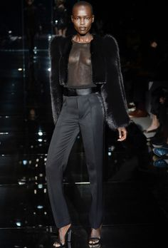 Tom Ford SS14 - Look 30 |  Black fox and mink bolero.  Black silk georgette long-sleeved blouse.  Black wool mohair grain de poudre high-waisted tuxedo men's pants.  Black suede sandals with mirror heel.