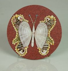"""""""Butterfly"""" miniature seashell mosaic or magnet on the cork."""