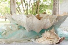 Oversized hand-formed seashell as a table centerpiece for an ocean-themed party