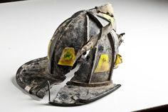 A fire helmet that was broken into pieces from Fire Department Squad 18 discovered in the debris after the terrorist attacks of Sept. 11, 2001.  Ira Block / National September 11 Memorial & Museum