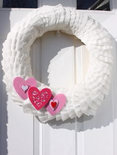 Coffee filter wreaths are super-popular -- here's one decked out Valentine's Day style! #valentinesday #crafts #diy