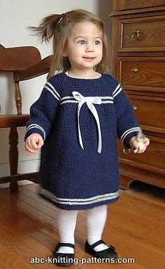 This is a quick, simple dress that's great for a not very experienced knitter. The dress is worked in garter stitch, top down, without seams or a back seam (optional; read more below). The yoke features raglan sleeve construction and decorative white stripes. There also stripes along the bottom of the skirt and the sleeves.