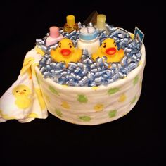 Bath Time with Rubber Duckie Diaper Cake. This is a great centerpiece for a duck-theme baby shower or a great gift for the parents-to-be.
