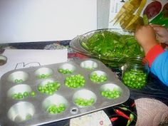 Developing fine motor skills and encouraging healthy eating through shelling peas.
