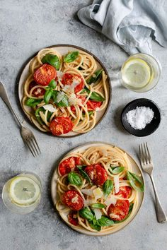 Two plates of bucatini pasta with oven roasted tomatoes #easyrecipe #bucatinipasta