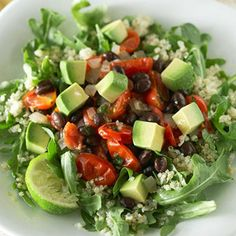 Black Beans and Avocado on Quinoa - black beans, onion, grape tomatoes, cumin, cilantro, lime, olive oil, salt, quinoa, spinach or arugula, avocado
