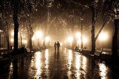 """Couple walking at alley in night lights"" - Vladimir Nikulin"
