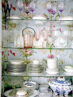 glass shelves against floral wallpaper background