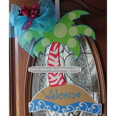 This whimsical, hand-painted, wooden palm/palmetto tree welcomes summer to your front door. It would be perfect for a beach house or to bring the beach closer to YOUR house. Palm Tree Welcome Door Hanger/Sign by SparkledWhimsy on Etsy, $35.00