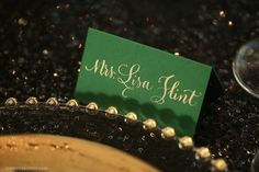 Photo by Kimberly Potterf  Place cards and hand calligraphy with gold ink by On Paper.