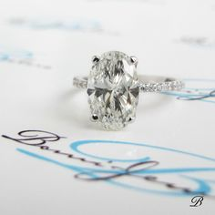 Oval and Skinny Diamond Engagement Ring