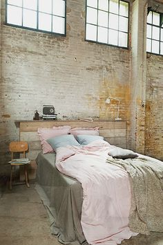 Bedding from Vtwonen - Bedroom with exposed brick wall - Warehouse conversion