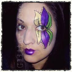 Mardi gras flower eye design. Painting by Glitter Goose. Face paint. #mardigras