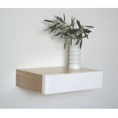 Pacco Floating Drawer: Birch White is a wall mounted shelf with integral drawer. This latest addition to the best-selling Pacco series is handmade in solid birch ply with a white semi-gloss drawer front. Use them on their own, or combine several floating shelves with drawers to make a unit.  A discreet grip underneath allows you to slide the drawer open. And the versatile and space saving design means you can use them in so many ways around your home.  You can mix and match them to create a…