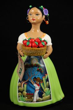 "- Lupita with Basket of Ripe Apples, Mexican Ceramic Figurine with a Lime Green Dress. - The figurine is 11-3/8"" tall and 6 1/4"" wide at the base. - Please note all details. This figurine has the Dres"