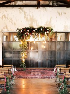 Organic Jewel Tone Austin Wedding at The Union on Eighth Industrial ceremony space + hanging autumnal blooms Industrial Wedding Inspiration, Industrial Wedding Decor, Industrial Table, Industrial Furniture, Vintage Industrial, Jewel Tone Wedding, Floral Wedding, Hanging Flowers Wedding, Wedding Altars