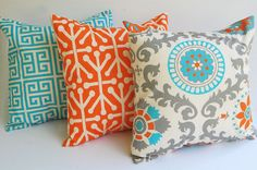 Set of three decorative throw pillow covers in medium grey, light grey, orange, aqua-turquoise, and natural. This fabric is printed on lightweight striated (has furrows or linear markings similar to linen) cotton duck. These covers are so gorgeous in person! Features: >Deep envelope closure so that inserts are not visible >Same print on front and back >Serged for a professional finish and to keep seams from fraying >High quality, durable thread >Professionally attached care tags >Finished…