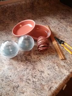 How wrapping wires around a terra cotta saucer will brighten your yard