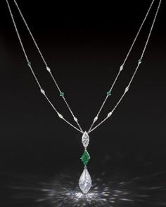 A MAGNIFICENT DIAMOND AND EMERALD PENDENT NECKLACE Suspending a briolette diamond weighing approximately carats, enhanced by a kite-shaped emerald weighing approximately carats and marquise-cut diamond weighing approximately carats, join Emerald Pendant, Emerald Necklace, Emerald Jewelry, Diamond Pendant Necklace, High Jewelry, Diamond Jewelry, Jewelry Necklaces, Jewellery, Ring Pops