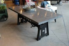 Copied from Rogue Decor site: Cast iron bottom, top adjusts from table height up to bar height by using the crank