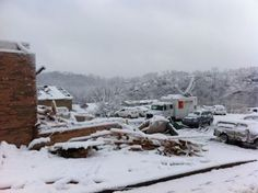 Snow on top of tornado damage.