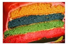 Multi-layered cake: yellow, blue, green and pink.